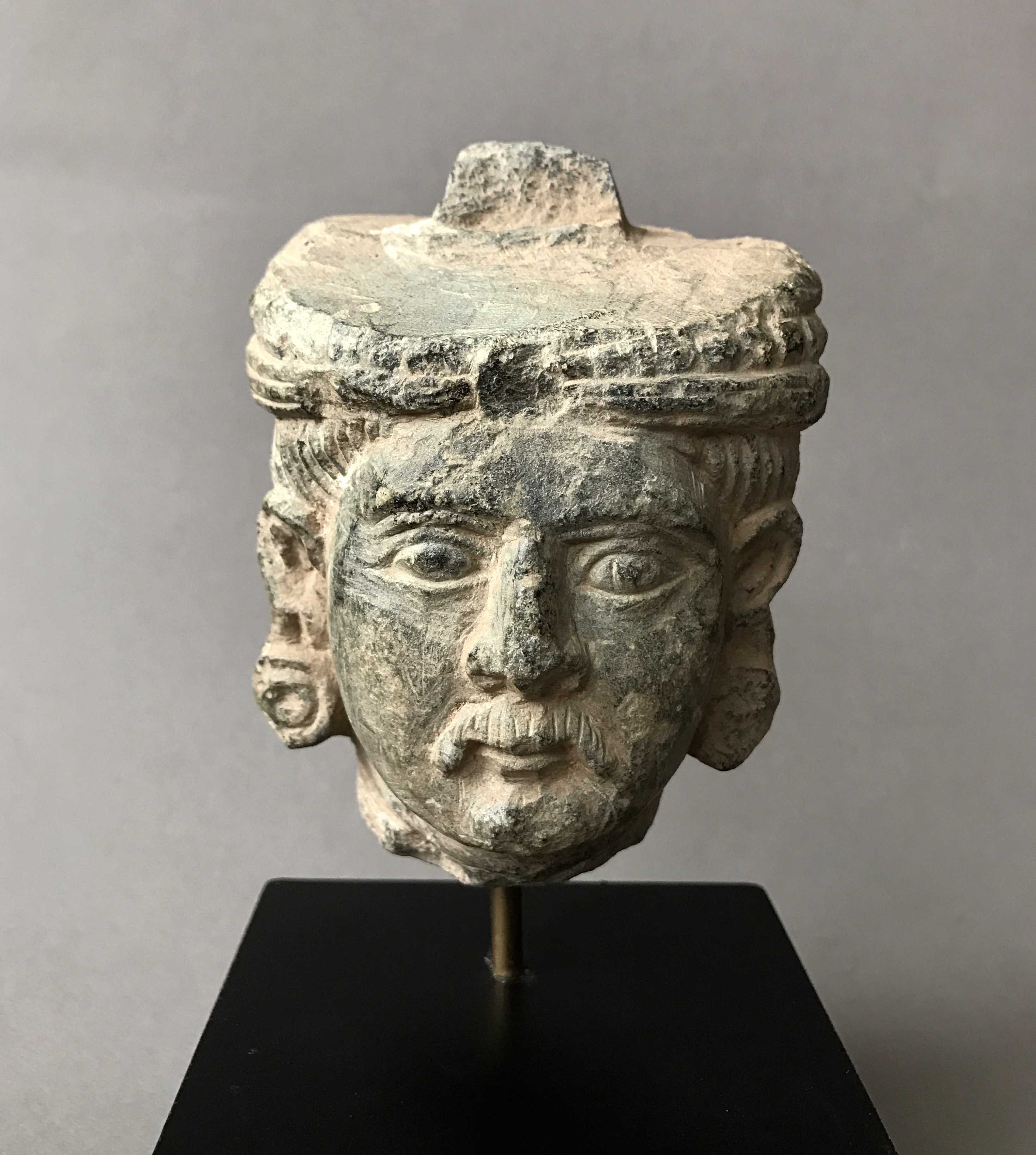 Finely carved ancient gandharan schist stone head with